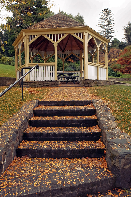 The leaf strewn steps in front of the gazebo.