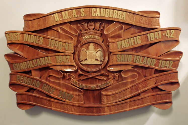 HMAS Canberra's ornate wooden plaque is one of the first sights to greet you on board.