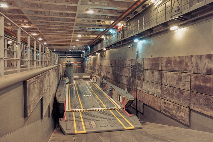 Hellooooooo, ellooooooo, ellooooooooooo. The cavernous lower deck of the ship which is able to carry up to 110 vehicles, including 4 of these kick-ass landing craft.