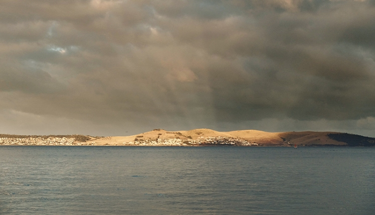 Anticrepuscular rays shine from the hillside opposite the setting sun near Tranmere on the far shore.
