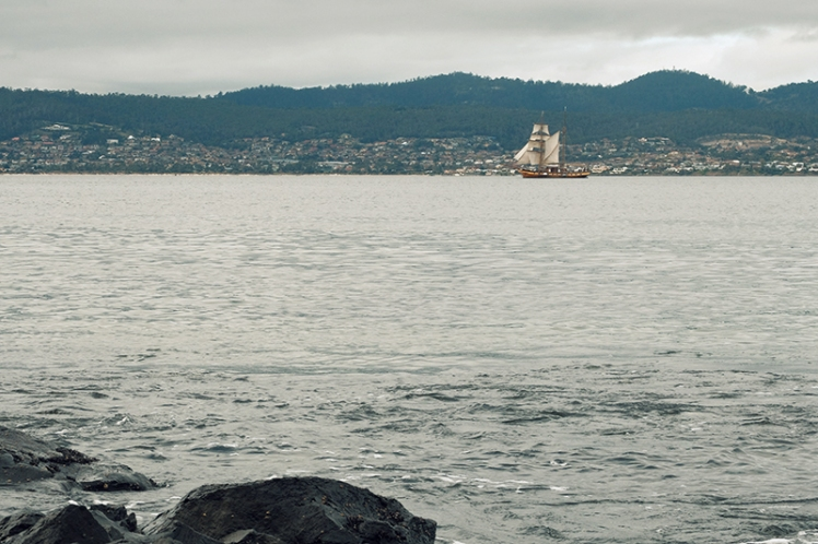 A tallship makes its way back to Hobart after going for a spin on the water.