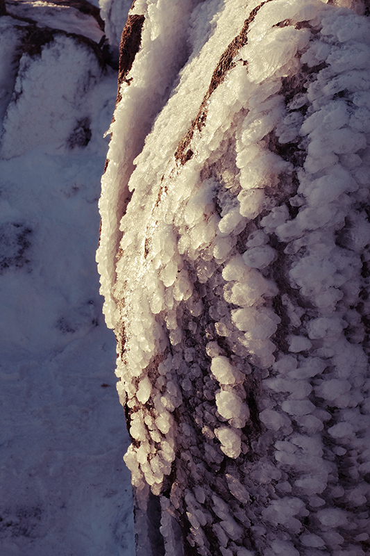 I was fascinated by these wind blown formations of icy snow on the exposed rocks following the direction of the wind.