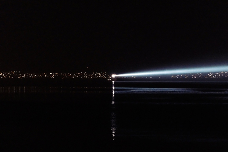 The night ship which was like a mobile lighthouse lit up the harbour each evening.